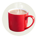 Steam rises from a red mug filled with coffee.