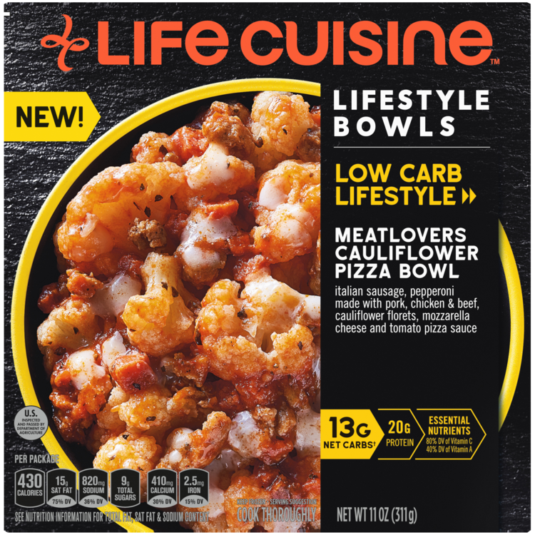 Front view photograph of a box of Creamy Chicken & Riced Cauliflower Bowl featuring the orange Life Cuisine logo and the Low Carb Lifestyle label beside the product name and a yellow bowl filled with cheesy cauliflower, pizza sauce, and sausage against a black textured surface.