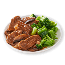Image of Lean Cuisine Steak Portabella on a white plate loaded with tender beef steak, portabella mushrooms and broccoli.
