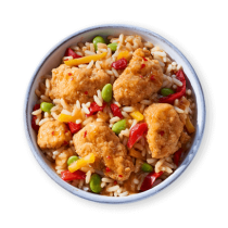 Image of Lean Cuisine bowls Orange Chicken in a white bowl loaded with breaded chicken, rice, edamame, and red and yellow peppers.