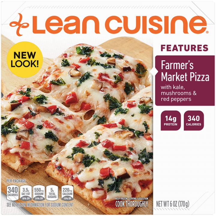 Front view photograph of a box of Farmer's Market Pizza Frozen Meal featuring the orange Lean Cuisine logo and the features label beside the product name and a crispy crust pizza with kale, mushrooms, and red peppers on a wood pizza paddle and a white surface.