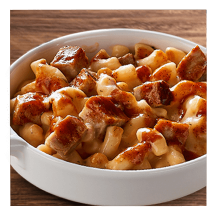 Dishes of chicken and BBQ pork Mac-FULLS™ on a wooden counter.