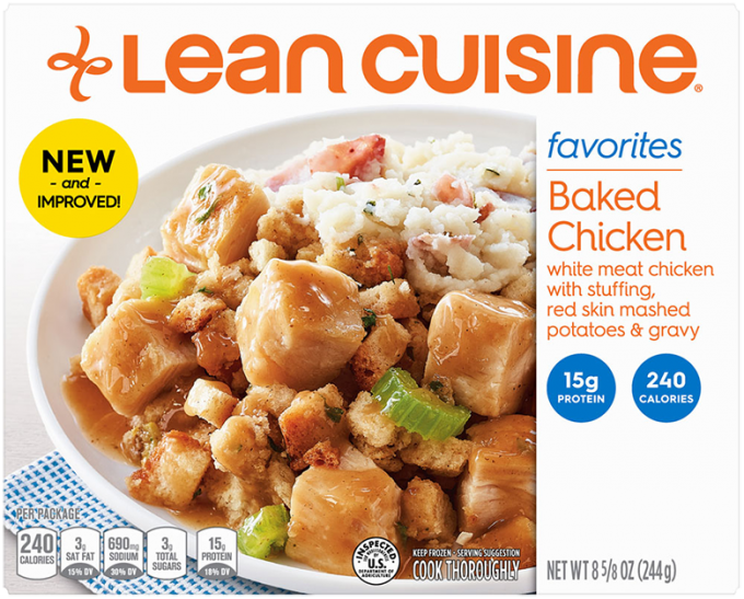 Front view photograph of a box of Baked Chicken Frozen Meal featuring the orange Lean Cuisine logo and the favorites label beside the product name and diced baked chicken tossed with stuffing and celery beside mashed potatoes in a white bowl on a blue polka dot napkin and white surface.