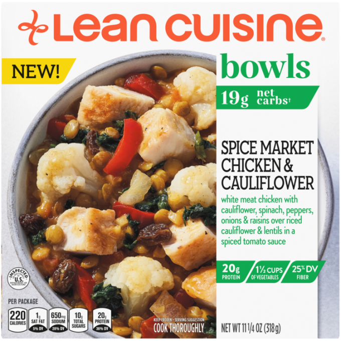 Front view photograph of a box of Spice Market Chicken and Cauliflower Bowl featuring the orange Lean Cuisine logo and the green bowls label beside the product name and chicken, cauliflower, spinach, peppers, onions & raisins over riced cauliflower & lentils with a spiced tomato sauce in a white bowl on a white surface.