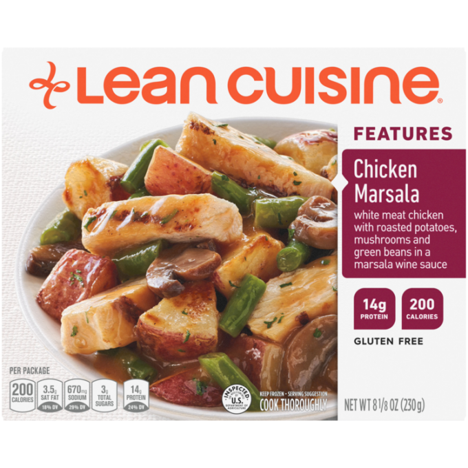 Front view photograph of a box of Chicken Marsala Frozen Meal featuring the orange Lean Cuisine logo and the features label beside the product name and chicken in a savory marsala wine sauce paired with a creamy mushroom and spring pea risotto in a white bowl on a white surface.