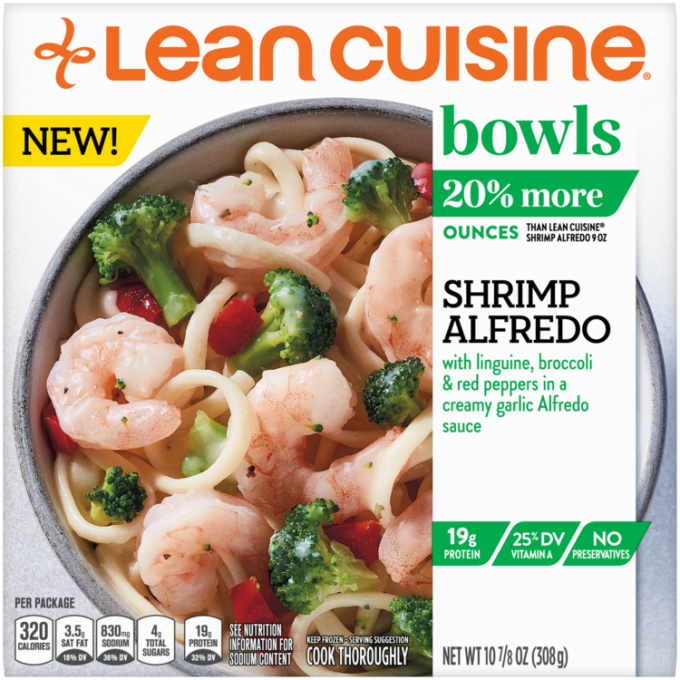 Front view photograph of a box of Shrimp Alfredo Bowl featuring the orange Lean Cuisine logo and the green bowls label beside the product name and shrimp, broccoli, pasta, and red peppers covered with alfredo sauce in a white bowl on a white surface.