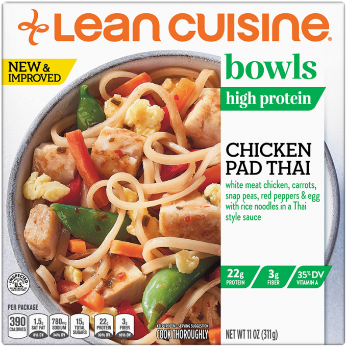 Front view photograph of a box of Chicken Pad Thai Bowl featuring the orange Lean Cuisine logo and the green bowls label beside the product name and rice noodles with chicken, carrots, egg, snap peas, and red pepper in a white bowl on a white surface.