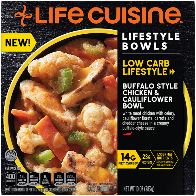 Front view photograph of a box of Buffalo Style Chicken & Cauliflower Bowl featuring the orange Life Cuisine logo and the Low Carb Lifestyle label beside the product name and a yellow bowl filled chicken, cauliflower, celery, and carrots against a black textured surface.