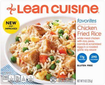 Front view photograph of a box of Chicken Fried Rice Frozen Meal featuring the orange Lean Cuisine logo and the favorites label beside the product name and a bed of rice loaded with chicken, carrots, peas, and scrambled eggs with a soy garlic sauce in a white bowl on a blue polka dot napkin and white surface.