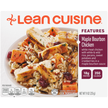 Front view photograph of a box of Maple Bourbon Chicken Frozen Meal featuring the orange Lean Cuisine logo and the features label beside the product name and chicken in a maple bourbon sauce with a side of pecan, sweet potato & cranberry rice in a white bowl on a white surface.