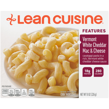 Front view photograph of a box of Vermont White Cheddar Mac and Cheese Frozen Meal featuring the orange Lean Cuisine logo and the features label beside the product name and macaroni with a creamy Vermont cheddar sauce in a white bowl on a white surface.