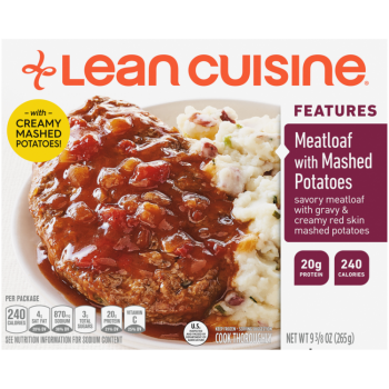 Front view photograph of a box of Meatloaf with Mashed Potatoes Frozen Meal featuring the orange Lean Cuisine logo and the features label beside the product name and meatloaf with gravy and a side of creamy red-skin mashed potatoes in a white bowl on a white surface.