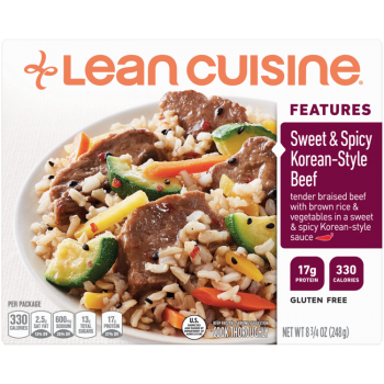 Front view photograph of a box of Sweet and Spicy Korean-Style Beef Frozen Meal featuring the orange Lean Cuisine logo and the features label beside the product name and beef, brown rice and vegetables with a sweet & spicy Korean-style sauce in a white bowl on a white surface.