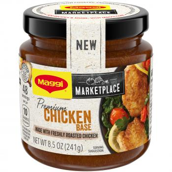 "Front view of a jar of MAGGI Premium Chicken Base with a black lid, ""NEW"" sticker, and light tan and yellow label featuring the MAGGI Marketplace logo and plate of cooked chicken breasts with tomato, lemon, and spinach."