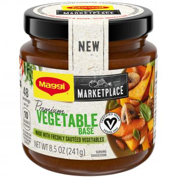 "Front view of a jar of MAGGI Premium Vegetable Base with a black lid, ""NEW"" sticker, and light tan and green label featuring the MAGGI Marketplace logo and a bowl of cooked squash, carrots, mushrooms, and peas."