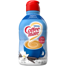 A bottle of French Vanilla Liquid Creamer with a red cap and blue label above a mug and vanilla beans.